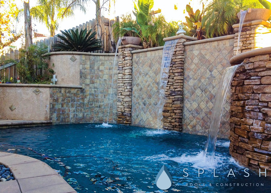 Swimming Pool in a Sloped Yard - Splash Pools & Construction, Inc.